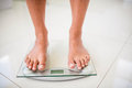 Feet of woman on weighting scale Royalty Free Stock Photo