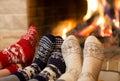 Feet in wool socks near fireplace in winter time Royalty Free Stock Photo
