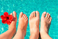Feet of a young couple by the pool Royalty Free Stock Photo