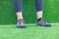 Feet of young woman on astro turf the legs and a resting some Stock Photos