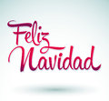 Feliz navidad merry christmas spanish text vector calligraphic lettering Stock Image