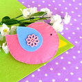 Felt pink bird toy decorated wooden sewing button flower Royalty Free Stock Photo