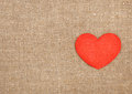 Felt red heart on the burlap background Royalty Free Stock Photography