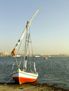 Felucca boat on the nile river bank aswan egypt Royalty Free Stock Images