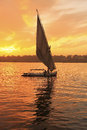 Felucca boat sailing on the nile river at sunset luxor egypt Stock Images