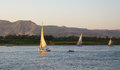 Felucca s on the nile three in egypt at luxor showing valley of kings in background Royalty Free Stock Images