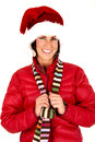 Femaile model portrait wearing a santa hat smiling Royalty Free Stock Photo