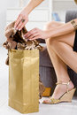 Femal hands packing out shopping bag Royalty Free Stock Images