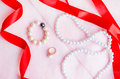 Female accessory on rosy pink background with red ribbon Royalty Free Stock Photo