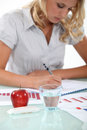 Female accountant going over records Stock Image