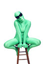 Female alien a young woman wearing a green body suit isolated on a white background with generous copyspace Stock Images