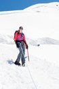 Female alpinist standing on glacier. Royalty Free Stock Photo