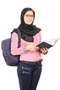Female arabic student with backpack holding a book and looking at camera isolated on white background Royalty Free Stock Image