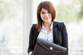 Female architect with a briefcase portrait of cute wearing suit and carrying while smiling Stock Photo