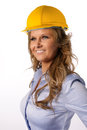 Female architect with helmet portrait of a beautiful wearing a yellow construction smiling attractive woman blond hair in the Stock Image
