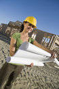 Female Architect Holding Blueprint Royalty Free Stock Photos