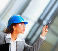 Female architect pointing upwards Royalty Free Stock Photography