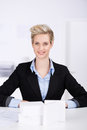 Female architect sitting at desk portrait of young in office Royalty Free Stock Photo