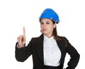 Female architect touching screen her finger white background Stock Image