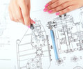 Female architect working with blueprints at office Royalty Free Stock Photo