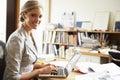 Female Architect Working At Desk On Laptop Royalty Free Stock Photo