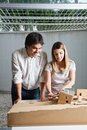 Female architect working on model house young male standing beside colleague Stock Photo