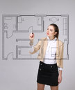 Female architect working with a virtual apartment plan Royalty Free Stock Photo