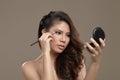 Female asian applying eye shadow Royalty Free Stock Photo