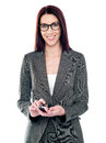 Female assistant using touch screen phone Royalty Free Stock Photo