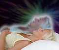Female astral projection experience woman lying supine with eyes closed experiencing Stock Image