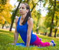 Female athlete athletic woman stretches before a run Royalty Free Stock Photography