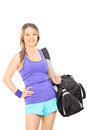 Female athlete carrying a sports bag isolated on white background Royalty Free Stock Photos