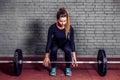 Female athlete doing deadlift at gym