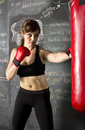 Female athlete hitting a punching bag Royalty Free Stock Photo