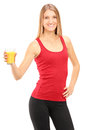 Female athlete holding a glass of juice Royalty Free Stock Image