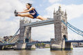 Female athlete hurdling tower bridge Stock Photography