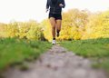 Female athlete jogging in park low section image of running young woman and exercising for good health Stock Photo