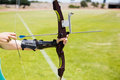 Female athlete practicing archery Royalty Free Stock Photo