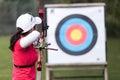 Female athlete practicing archery in stadium Royalty Free Stock Photo