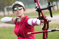 Female athlete practicing archery in stadium Royalty Free Stock Photo
