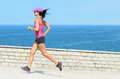 Female athlete running on vacation Stock Photo