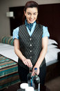 Female attendant serving beverages Royalty Free Stock Photography