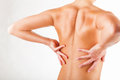 Female back woman with pain in the on a white background Royalty Free Stock Photo