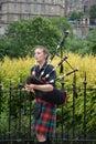 Female Bagpipe player in Edinburgh, Scotland Royalty Free Stock Photo