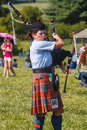 Female bagpipe player in record heat at the scottish games in the plains virginia a woman walks through the crowds playing the Royalty Free Stock Photography