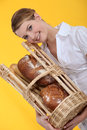 Female baker holding bread Royalty Free Stock Photo