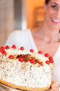 Female baker or pastry chef with torte Stock Photo