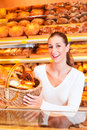 Female baker selling bread in her bakery Stock Photos