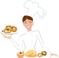 Female baker with sweet pastry smiling Royalty Free Stock Photography