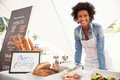 Female Bakery Stall Holder At Farmers Fresh Food Market Royalty Free Stock Photo